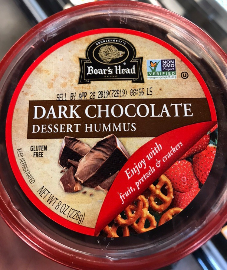 Container of dark chocolate dessert hummus