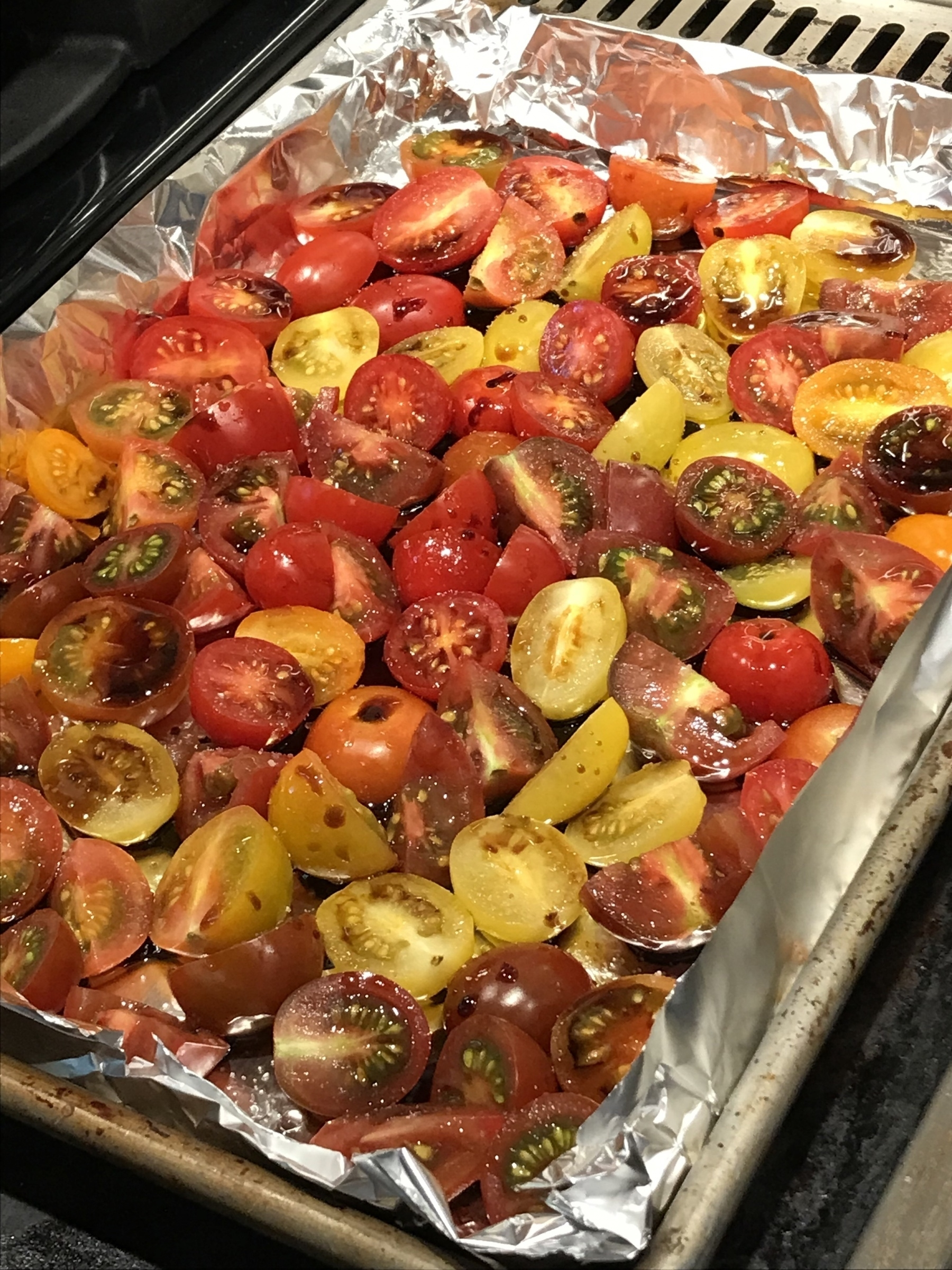 Sliced cherry tomatoes with olive oil and balsamic